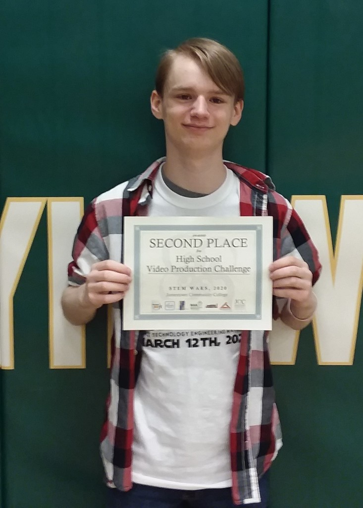 Student holds up his Second Place certificate for the Video Production Challenge