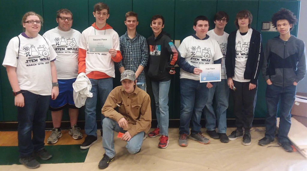 Students hold up their 1st and 2nd place certificates for the Rube Goldberg Competition